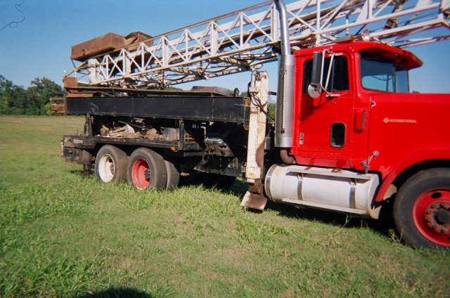 """5-1/4"""" retractable table, 24' kelly, 5 x 6 Gardner Denver mud pump, 30,000# pulldown, mounted on 1988 International truck 365 hp engine, PTO, 1 front 2 rear ..."""